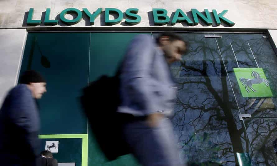 People walk past Lloyds branch