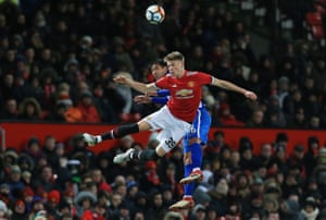 Manchester United's Scott McTominay and Brighton's Leonardo Ulloa challenge for a header as United win 2-0 and progress to the semi-finals of the FA Cup at Old Trafford.