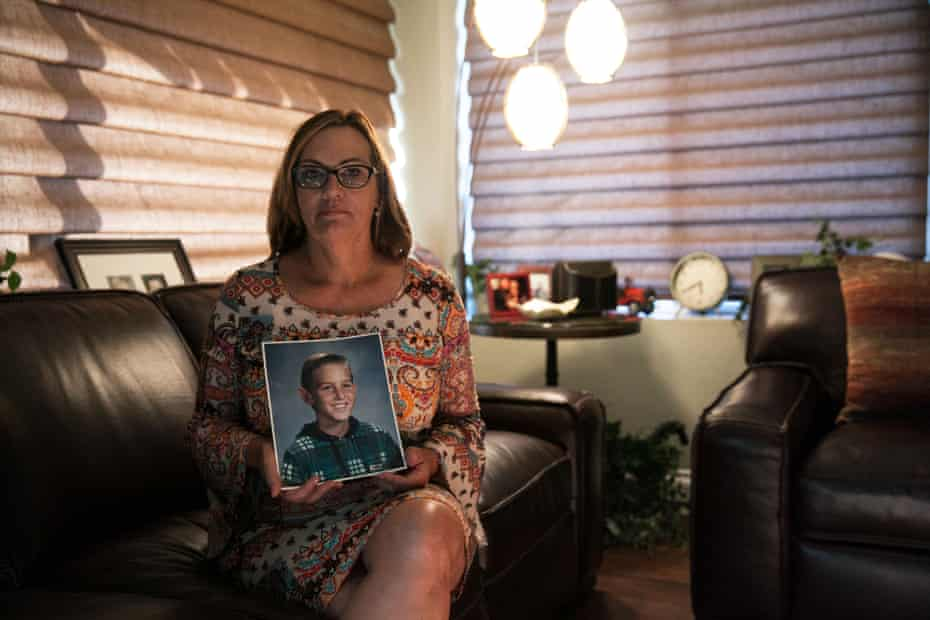 Sherrie Rubin holds a picture of Aaron when he was child.