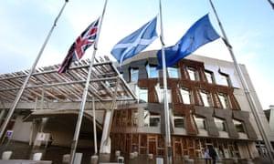 A union flag, a Saltire and the EU flag outside the Scottish parliament in Edinburgh.