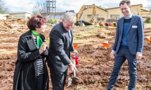 Carol Taylor, the deputy mayor of Toowoomba, and former MP Ian Macfarlane with Luke Terry, from Vanguard, breaking the soil of the Vanguard laundry and career development centre