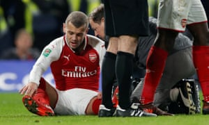 Arsenal's Jack Wilshere receives medical attention.