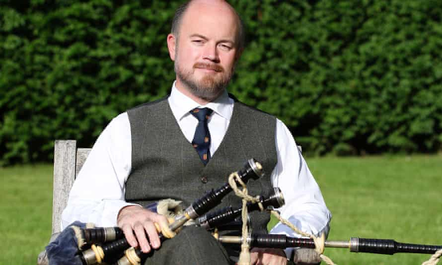 Prof Calum Semple with his bagpipes