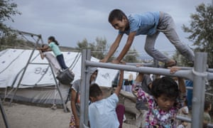 Children at a makeshift camp outside Moria. Around 13,000 people — more than four times the site's capacity — are currently housed there