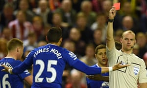 Everton's Ramiro Funes Mori is sent off by Bobby Madley during a match at Liverpool in April 2016