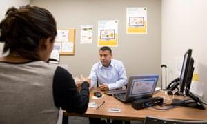 A food bank coordinator, Eddie Sanchez, meets with a client in Austin, Texas.