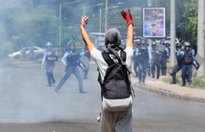 Tegucigalpa, HondurasA student of the National Autonomous University of Honduras (UNAH) confronts riot police during a protest against the government of Honduran President Juan Orlando Hernandez