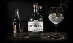 Short Cross Gin, close up of gin bottle and gin-filled glass with ice.