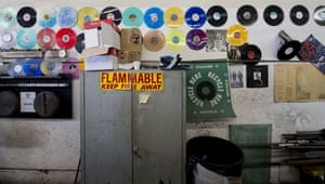 Samples of colored records line the walls at the record pressing plant