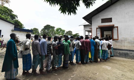 People stand in a queue to check their names on the final list of the National Register of Citizens in an office in Pavakati, Morigaon district