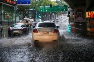 A car negotiates flooded streets in Sydney's Rushcutters Bay