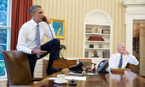 Obama asks congress to back action.  A photo made available by the White House press office shows US President Barack Obama, his right foot resting on the edge of his desk, in a telephone conversation in the Oval office with the Speaker of the House  John Boehner late 31 August 2013. On right listening is US vice president Joe Biden. EPA/PETE SOUZA