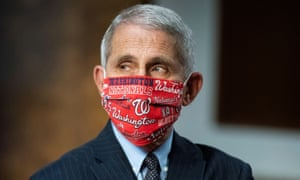 Anthony Fauci arrives on Capitol Hill to testify in the Senate about coronavirus. He's wearing a mask reflecting his deep love of the Washington Nationals baseball team.