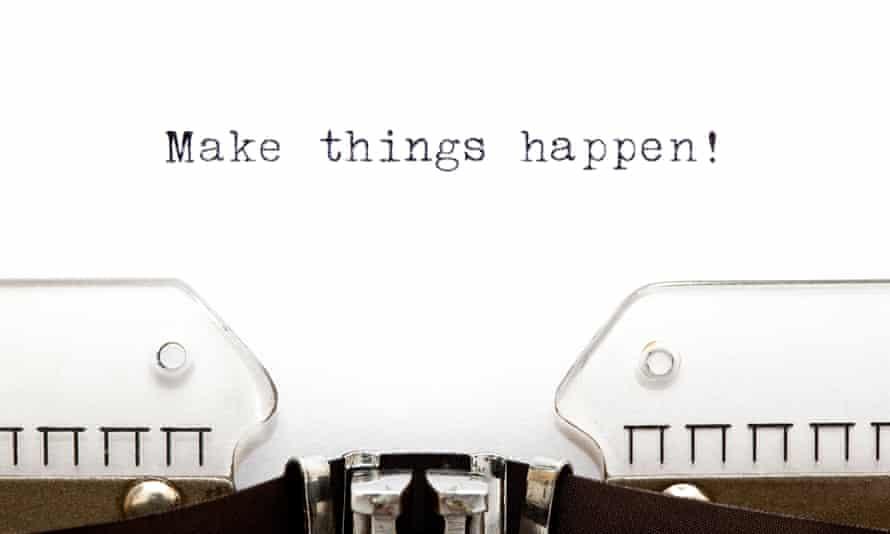 Typewriter keyboard ribbon with Make things happen written on paper