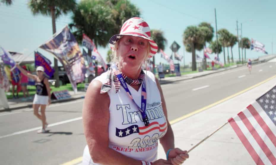 A supporter waves the flag for Trump in Florida.