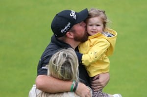 Lowry celebrates winning the Claret Jug with his wife Wendy Honner and daughter.