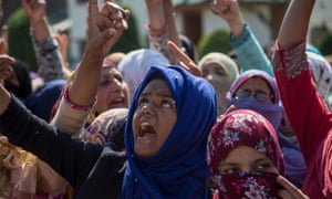 Kashmiri women shout slogans during a protest in Srinagar, the capital of Indian-controlled Kashmir