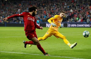 Mohamed Salah curls the ball into the net from a very acute angle.
