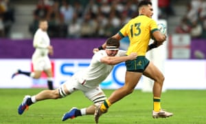 England's Tom Curry, left, tackles Jordan Petaia of Australia. Curry's defence will be key against New Zealand next weekend.