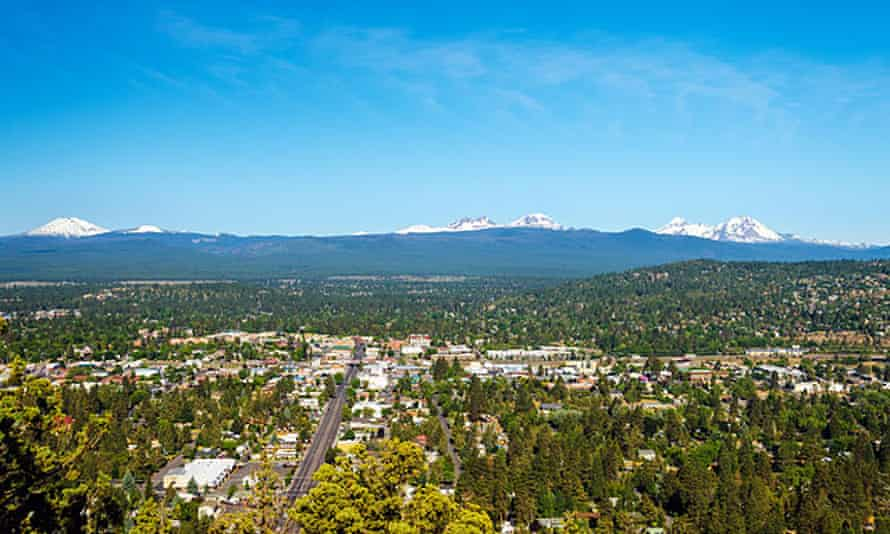 Aerial view of Bend and, in the distance, mountains in the Cascades range in Central Oregon.