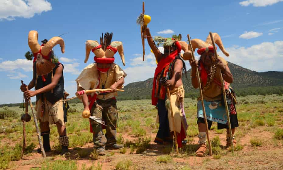 Havasupai ram dancers in front of Red Butte Mountain after performing their ceremonial dance at the tribal gathering last month to protest uranium mining