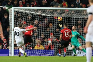 Ashley Barnes drills Burnley's opening goal past David de Gea.