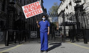 Dr Meenal Viz protests outside Downing Street in London.
