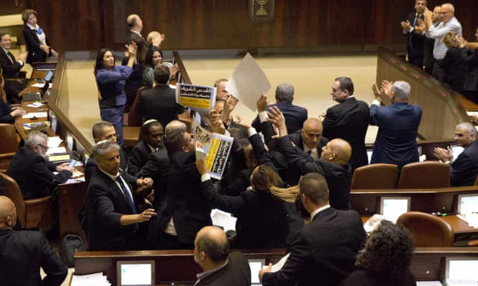 During a speech in the Knesset by US vice-president Mike Pence, Israeli Arab lawmakers are ejected for protesting against the US decision to recognise Jerusalem as Israel's capital.