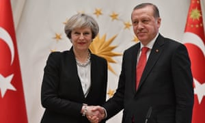 May shakes hand with Erdogan in Ankara