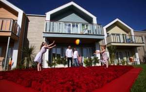 Somerset, UK Sienna, Steve, Jo, and Lilly-Grace Perkins, enjoy some family time in the installation of Sir William Butlin roses at the new West Lakes Chalet Village resort