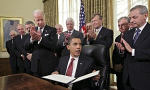 Obama is applauded by retired senior military leaders and Joe Biden after signing an executive order closing the prison at Guantánamo Bay.