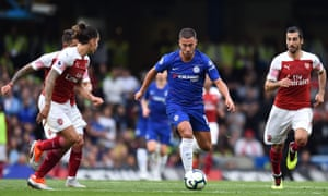 Chelsea's Eden Hazard surges forward.