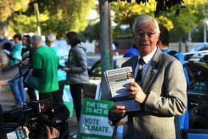 Greens candidate for Kooyong Julian Burnside campaigns outside of the Glenferrie primary school polling station.