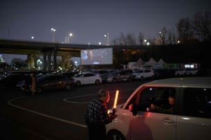 People arrive at the drive-in.