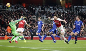 Arsenal's Laurent Koscielny, second right sees his header on goal saved by Chelsea goalkeeper Kepa Arrizabalaga.