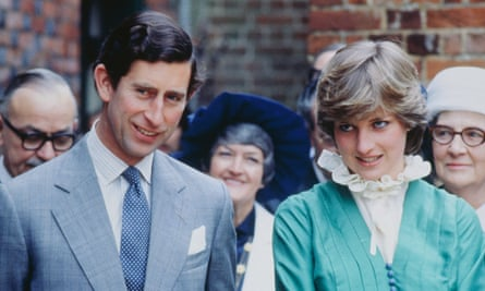 Charles and Diana Spencer standing next to each other in public
