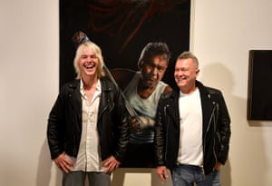 Artist Jamie Preisz and singer Jimmy Barnes pose with the packing room prize-winning portrait at the Art Gallery of New South Wales on Thursday.