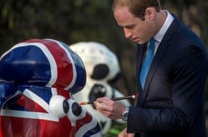 Prince William, Duke of Cambridge paints the eye of Shaun the Sheep at the British Ambassador's official residence. The Duke of Cambridge is the most senior royal to visit China since the Queen and Duke of Edinburgh in 1986