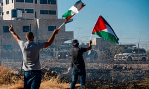 Palestinians protest against an Israeli court-ordered demolition notice for buildings in Beit Sahur, West Bank, July 2019