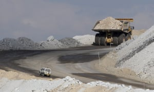 In this 2012 file photo a four-wheel-drive vehicle follows a large mining truck as it makes its way to the top of a coal mine near Gunnedah, Australia, northwest of Sydney.