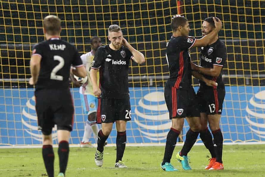 DC United forward Alvaro Saborio (9) celebrates with Lamar Neagle (13).