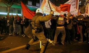 Greek riot police clash with anti-Obama protesters in Athens.