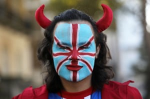 A protester wearing the union jack and devil horns.