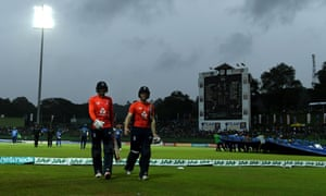 Joe Root and Eoin Morgan leave the field after rain stops play.