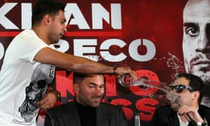 Amir Khan throws a glass of water over Phil Lo Greco