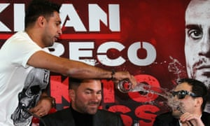 Amir Khan throws a glass of water over Phil Lo Greco during a press conference in January.