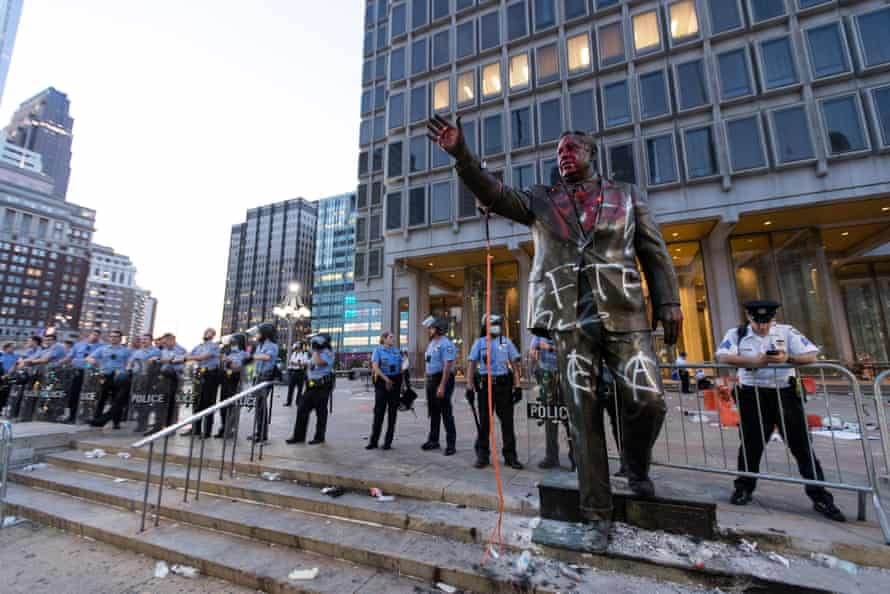 Pennsylvania police behind a defaced statue of Frank Rizzo.