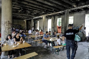 A war-damaged building is used as a mess hall for the migrants in Bihać.