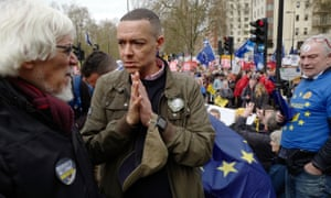 Clive Lewis MP, centre, talks to members of the public during the Put It To The People March on 23 March 2019 in London.