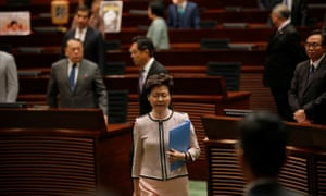 Hong Kong Chief Executive Carrie Lam reacts as lawmakers shout slogans, disrupting her annual policy address at the Legislative Council in Hong Kong.